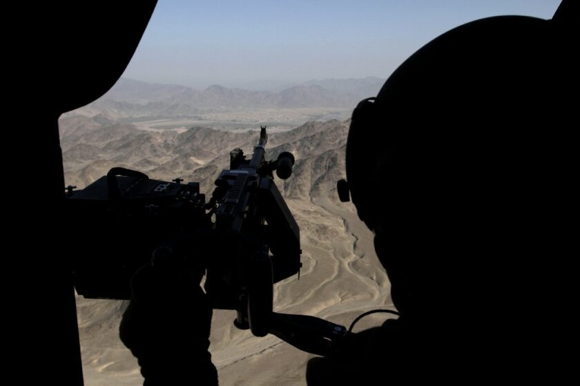 A U.S. soldier provides security from a helicopter during a flight near Jalalabad, Afghanistan.