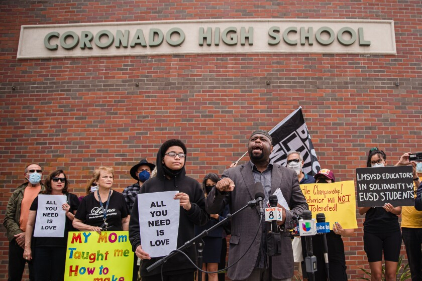Yusef Miller with the Racial Justice Coalition of San Diego speaks at a rally in front of Coronado High School.