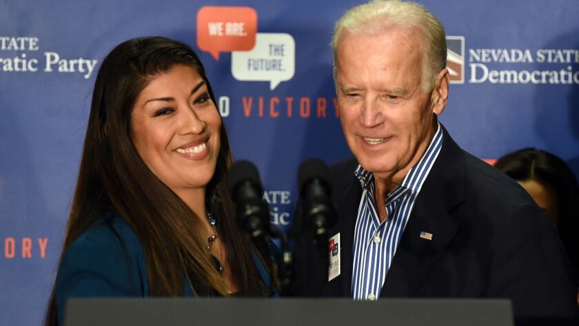 Then-Vice President Joe Biden with Lucy Flores at a Las Vegas rally on Nov. 1, 2014. Flores says some of Biden's behavior made her uncomfortable.