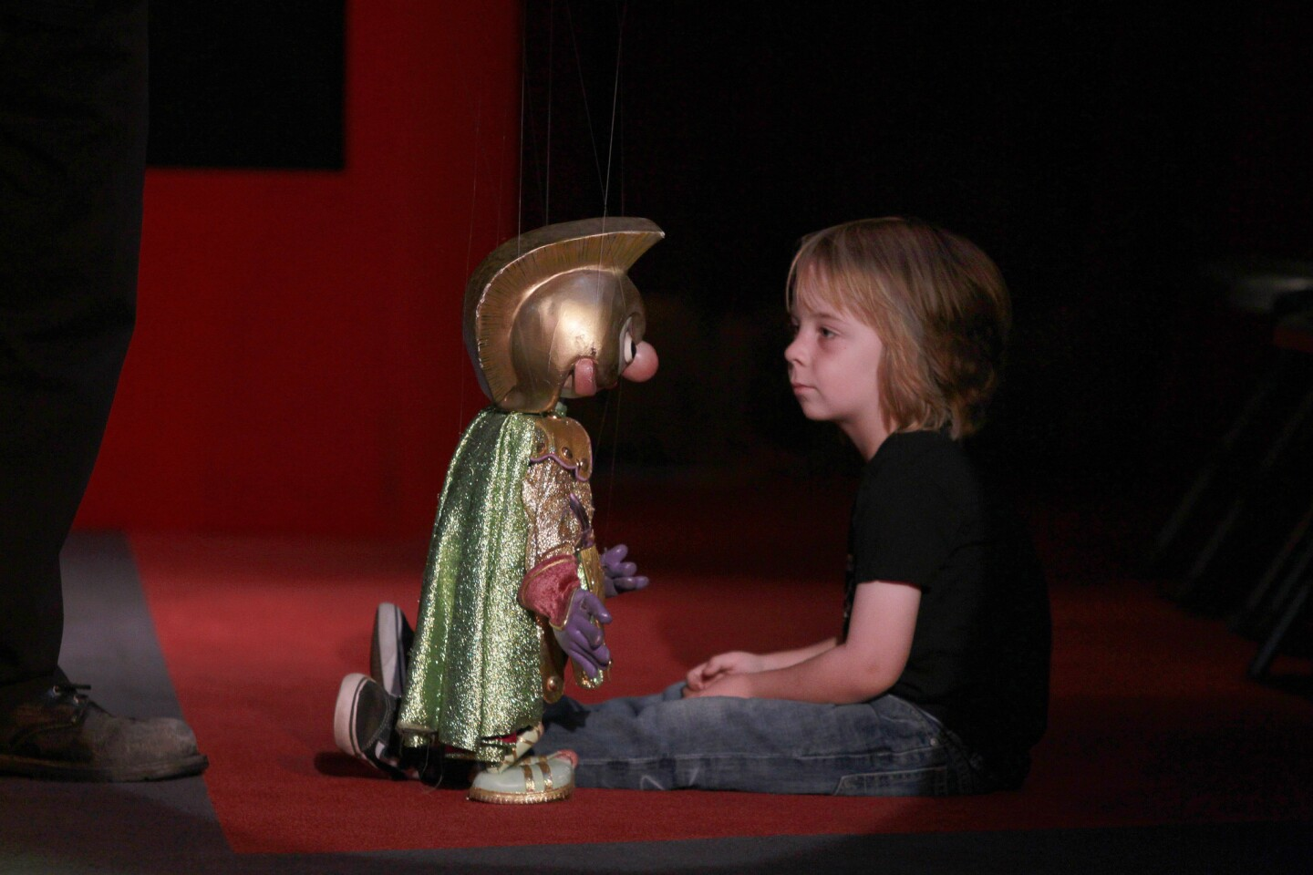 Shane McCullough, 4, comes face to face with a puppet during a show at the Bob Baker Marionette Theater in Echo Park.