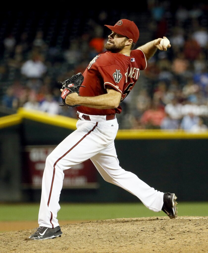 Arizona Diamondbacks Josh Collmenter throws against the Colorado Rockies during the seventh inning of a baseball game, Wednesday, April 29, 2015, in Phoenix. (AP Photo/Matt York)
