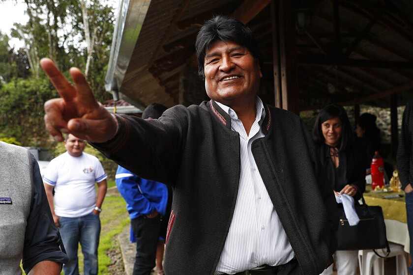 Evo Morales, Bolivia's first indigenous president, greets members of the media as he visits a trout farm in Incachaca on Saturday.