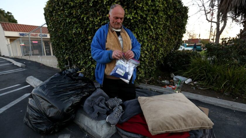John Wagner, 54 and 14 years homeless, holds the City Net care package given to him while on the 600