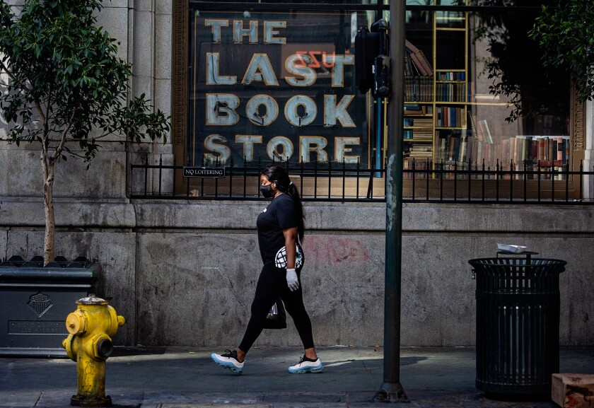 A woman walks by the Last Bookstore in downtown Los Angeles.