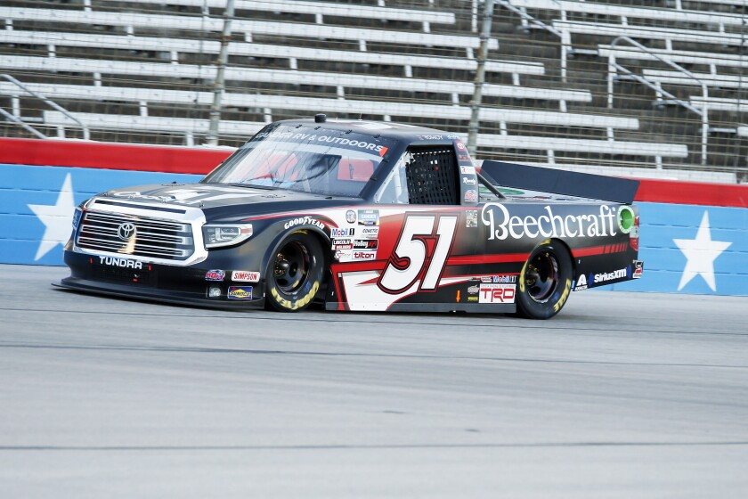 Kyle Busch heads down the front stretch during a NASCAR Trucks race at Texas Motor Speedway in Fort Worth, Texas, Saturday, July 18, 2020. (AP Photo/Ray Carlin)
