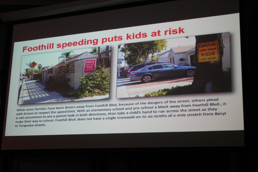 This 'slide' in Tom Coat's presentation reads: 'While some families have been driven away from Foothill Boulevard because of the street, others plead with drivers to respect the speed limit. With an elementary school and preschool a block away, it is not uncommon to see a parent look in both directions, then take a child's hand to run across the street as they make their way to school. Foothill Boulevard does not have a single crosswalk on its six-tenths of a mile stretch from Beryl to Turquoise streets.'