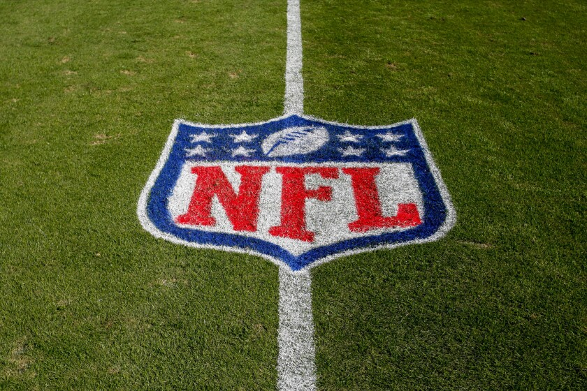 NFL logo painted on grass.