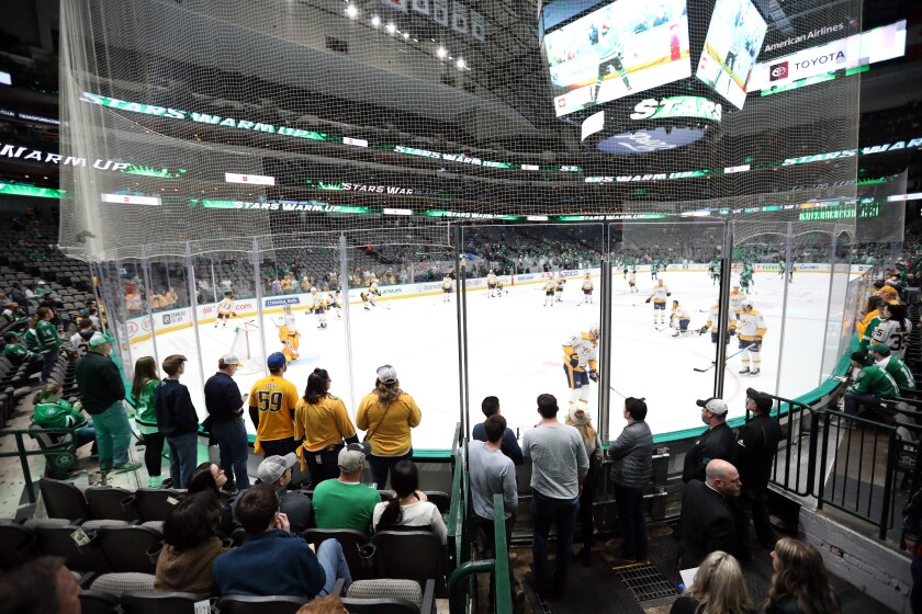 Fans watch warm ups before a game between the Nashville Predators and the Dallas Stars at American Airlines Center on March 7.