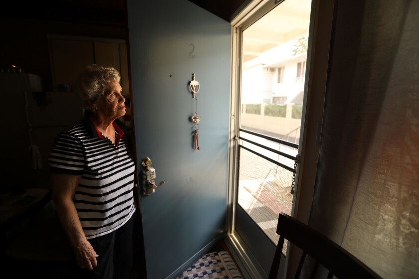 HOLLYWOOD, CA - SEPTEMBER 26, 2018 - - Carol Thompson, 75, looks out the front door of her apartment
