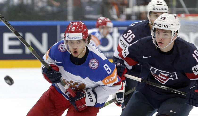 FILE - In this May 16, 2015, file photo, Jimmy Vesey, right, of the United States, chases the puck with Russia's Artemi Panarin, left, during a World Championships semifinal match in Prague, Czech Republic. The New York Rangers announced Friday, Aug. 19, 2019, it agreed to terms on an entry-level d