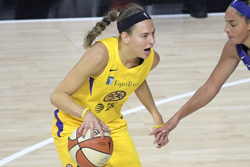 Los Angeles Sparks guard Sydney Wiese, left, sets up for a play in front of Phoenix Mercury guard Bria Hartley.