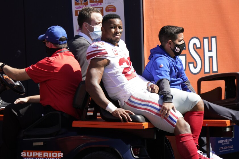 New York Giants running back Saquon Barkley is transported to the locker room after being injured.
