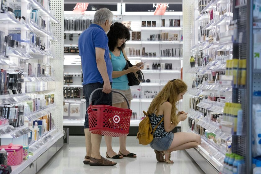 In this Aug. 21, 2015 photo, people shop at the CityTarget store in Boston. Plummeting stock prices have taken a toll on U.S. consumer confidence, though there are signs the setback may be temporary. The University of Michigan says its consumer sentiment index fell to 91.9 Aug. 2014 from 93.1 in July. The index is still up 11.4 percent from a year ago. (AP Photo/Michael Dwyer)