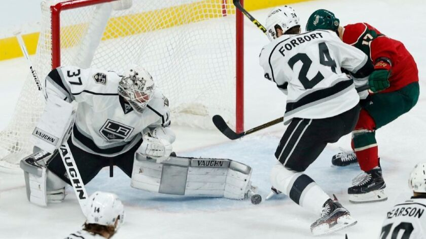 Kings goaltender Jeff Zatkoff stops a shot during a game against the Wild on Oct. 18.