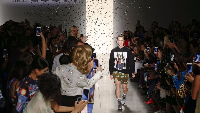 Designer Jeremy Scott is showered in confetti at the end of the runway show, which marked a 20th ann