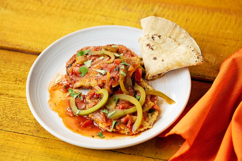 Tuna patties served with a tomato-based broth with onions, tomatoes and bell peppers.