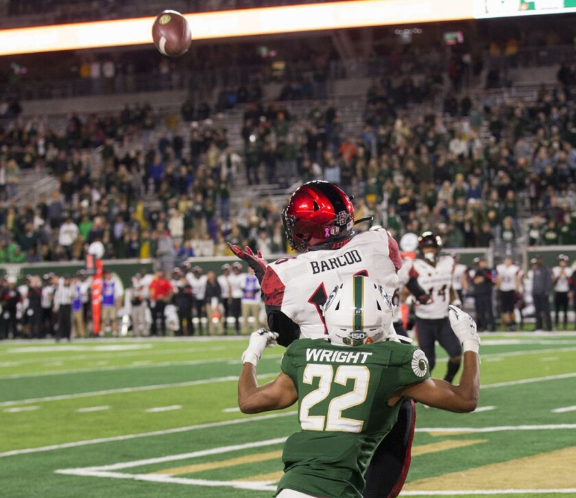 San Diego State cornerback Luq Barcoo steps in front of Colorado State's Dante Wright to make the first of his three interceptions against the Rams.