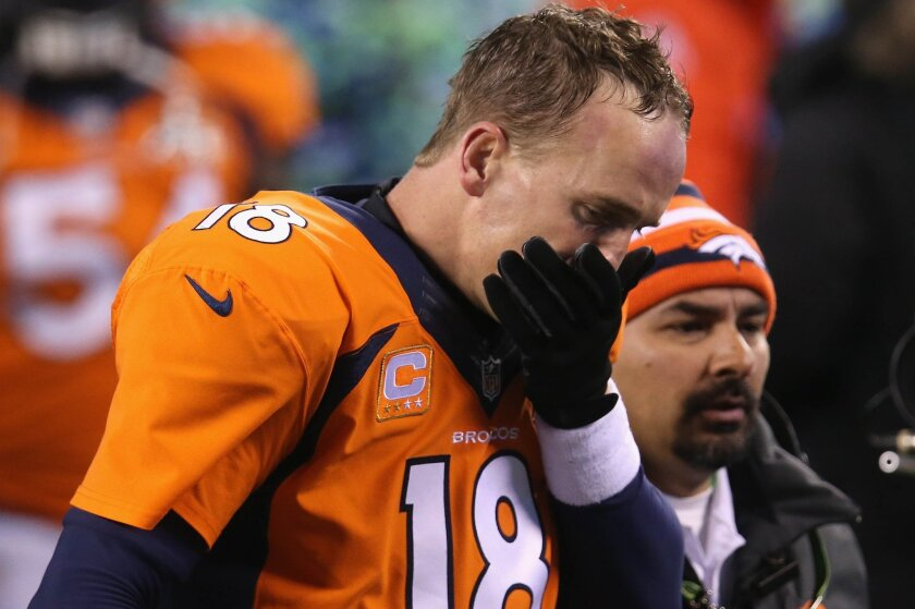 Broncos quarterback Peyton Manning walks off the field after Denver's loss to Seattle on Sunday.