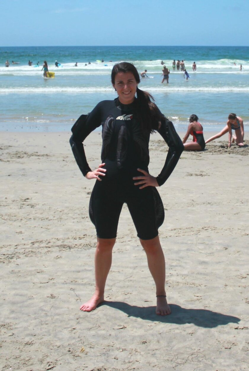 La Jolla Light reporter María José Durán wears a Wave Wrecker suit before taking it to the water for a test.