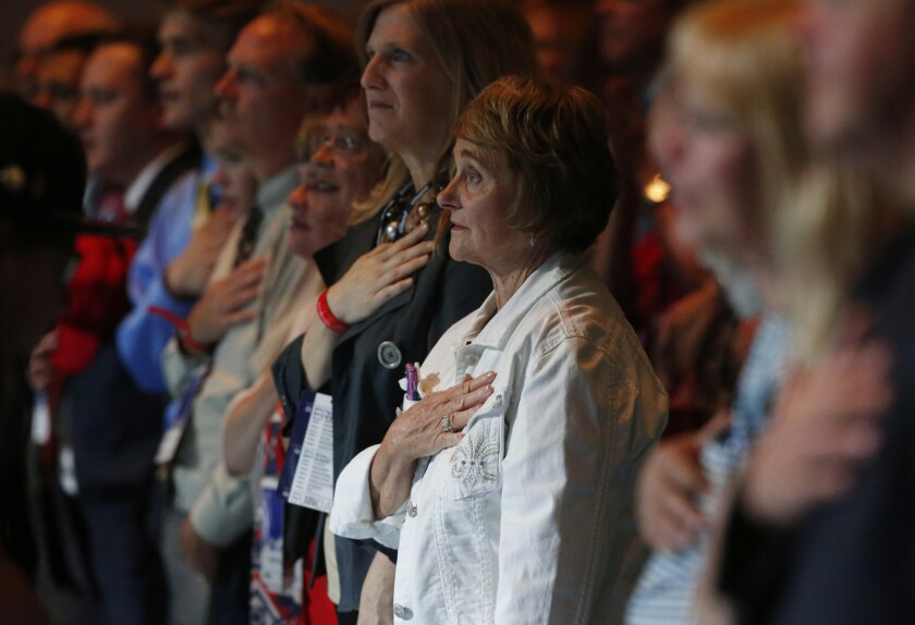 Participants stand to recite the Pledge of Allegiance at the Western Conservative Summit in Denver on Friday.