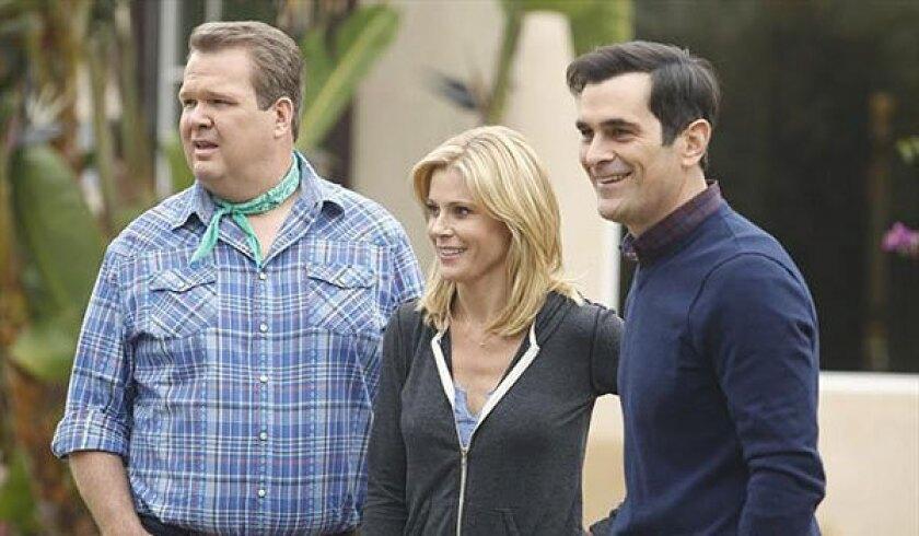 """Modern Family's"" Eric Stonestreet, from left, Julie Bowen and Ty Burrell."