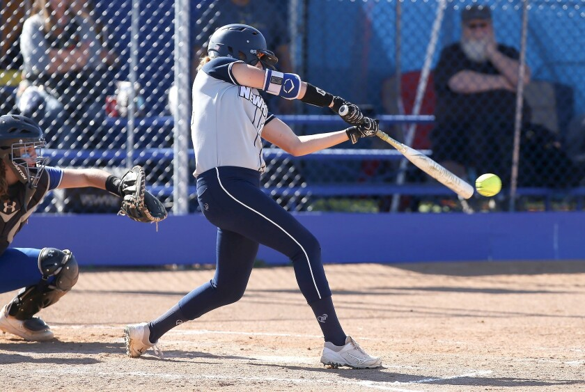 Newport Harbor's Eliana Gottleib drives the ball for a single during Wave League softball game again