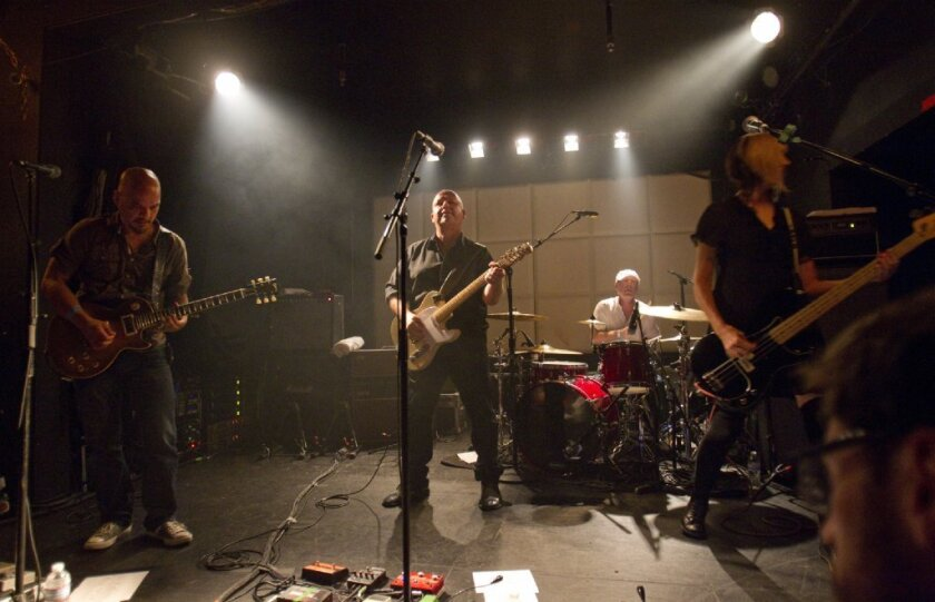 The Pixies, from left lead guitarist Joey Santiago, singer/guitarist Black Francis, drummer David Lovering and new bassist Kim Shattuck, perform at the Echo in Los Angeles on Friday.
