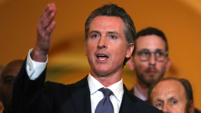 Gov. Gavin Newsom announces a moratorium on California's death penalty during a news conference at the state Capitol on March 13.
