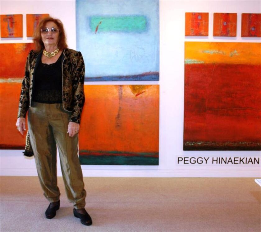 Peggy Hinaekian with her work.