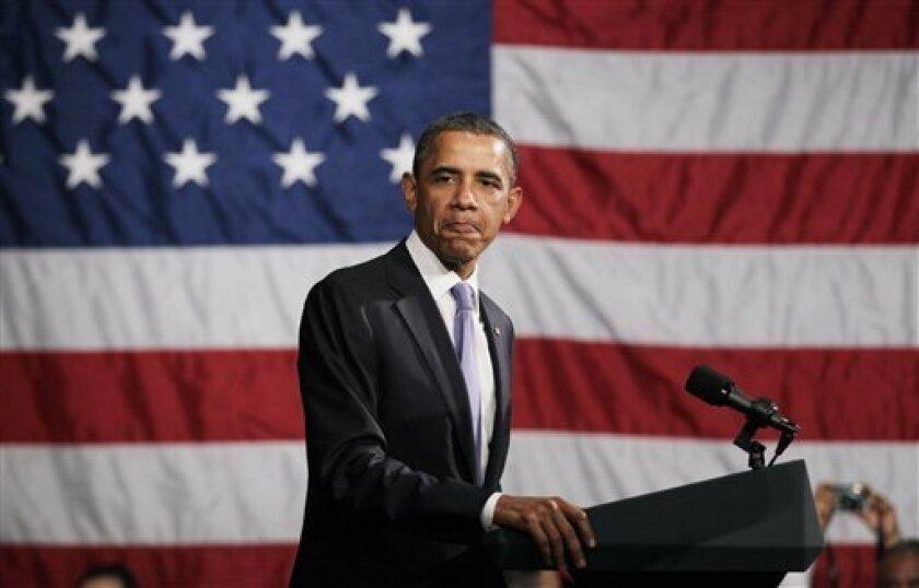 President Barack Obama pauses as he  speaks during Democratic National Committee event at the Hyatt at The Bellevue, Thursday, June 30, 2011, in Philadelphia.  (AP Photo/Carolyn Kaster)