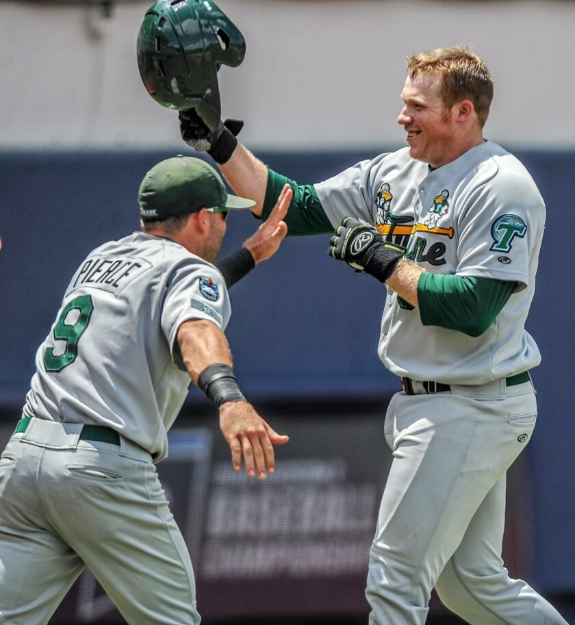 Tulane's Hunter Williams (39) is congratulated by Shea Pierce (9) after hitting his second home run against Mississippi in an NCAA regional college baseball tournament game at Oxford-University Stadium in Oxford, Miss., on Saturday, June 4, 2016. (Bruce Newman /The Oxford Eagle via AP)  NO SALES; M