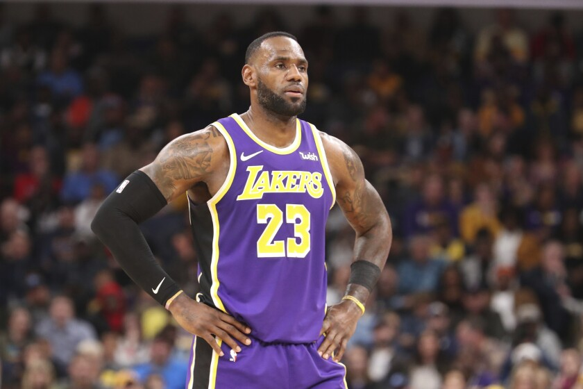 Lakers forward LeBron James pauses on the court in the second half against the Memphis Grizzlies on Saturday.