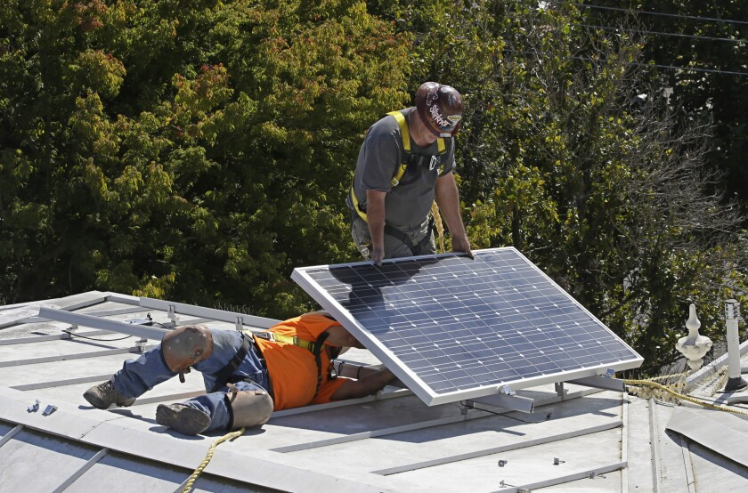 A solar panel is installed on the roof of the Old Governor's Mansion State Historic Park on Oct. 16, 2015, in Sacramento as part of the renovation of the building.