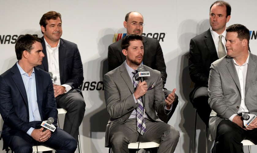 NASCAR driver Denny Hamlin, center, speaks to the enhanced competition format that will be implemented in all three of NASCAR's national series beginning this season.