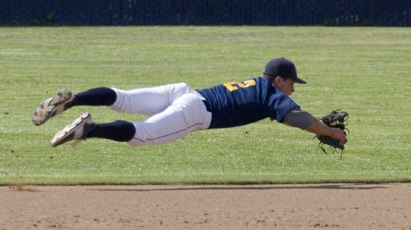 Marina High's Griffin Hennessey jumps on the ball before throwing the runner out at first base during the second inning against Corona.