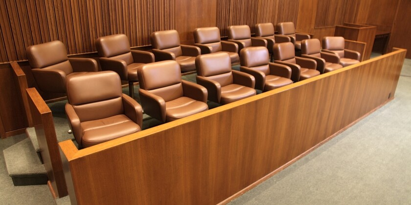 In this photo, a jury box sits empty.
