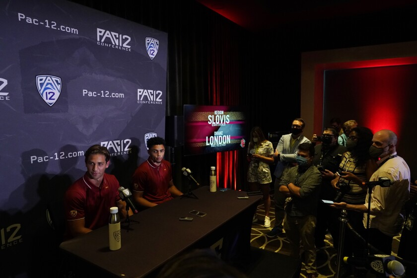 Southern California quarterback Keldon Slovis, left, and wide receiver Drake London answer questions during the Pac-12 Conference NCAA college football Media Day Tuesday, July 27, 2021, in Los Angeles. (AP Photo/Marcio Jose Sanchez)