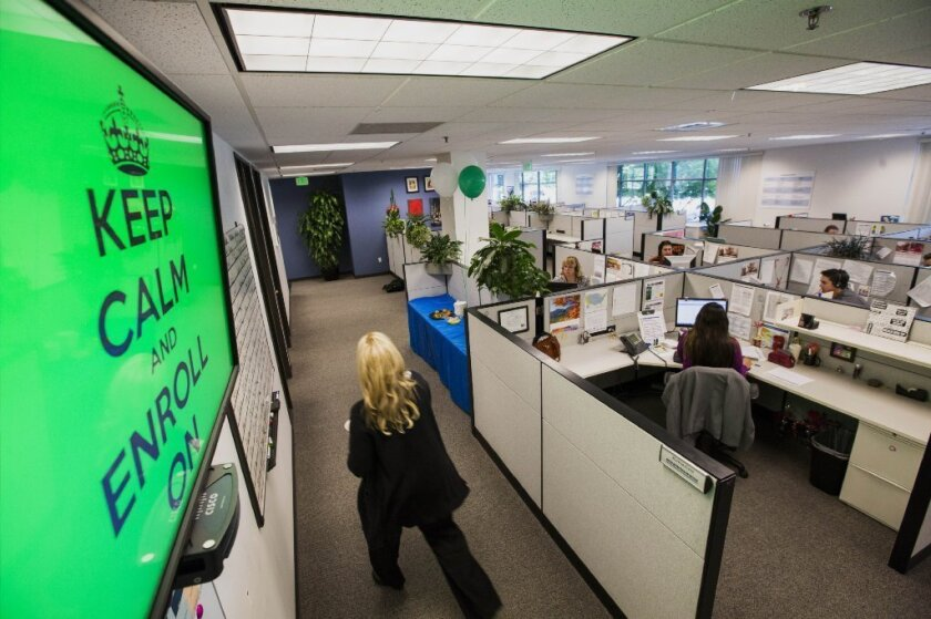 EHealth call-center employees answer the phones in October in Sacramento. The company released new data Wednesday showing average premiums paid for Obamacare coverage.
