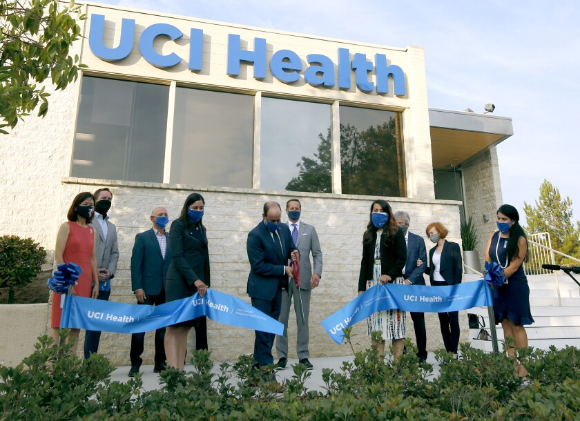UCI Health CEO Chad Lefteris cuts the ribbon.