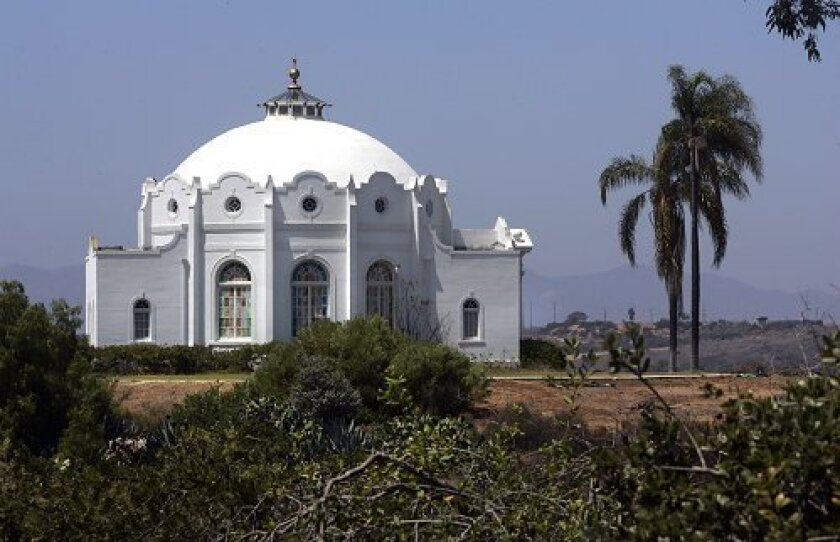 """The Rosicrucian Fellowship's Mission/Spanish Revival healing temple, known as """"The Ecclesia,"""" overlooks the San Luis Rey River Valley in Oceanside."""