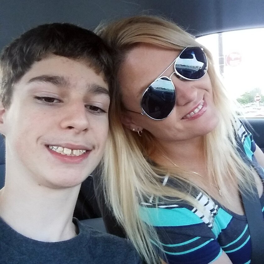 In this undated selfie, Alex Hoover, left, poses for a photo with his mother, Rene. Alex Hoover, an Alabama teen with a terminal heart condition has not returned to school after a spate of hospitalizations because of what his mother says is a dispute with school officials about how he might die. (R