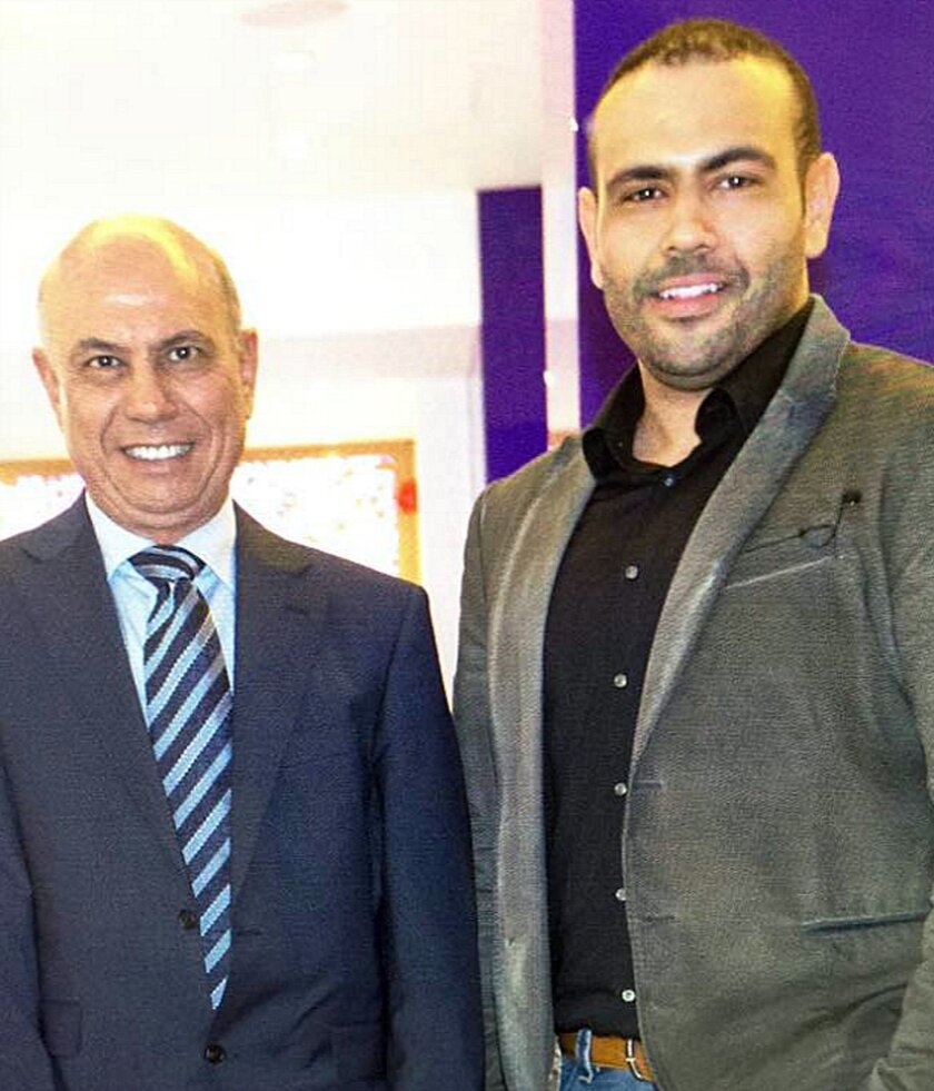FILE- This undated file photo made available by Amal Eldarat, a family relative, shows Kamal Eldarat, left, and his son Mohammed Eldarat. The Two Libyan Americans, detained in the United Arab Emirates since August 2014, have been acquitted of charges they illegally raised funds for a foreign entity