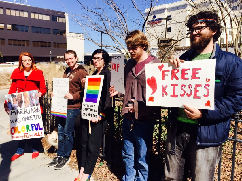 A group from the University of West Florida rallies in support of same-sex marriage outside the U.S. District Courthouse in Mobile, Ala.