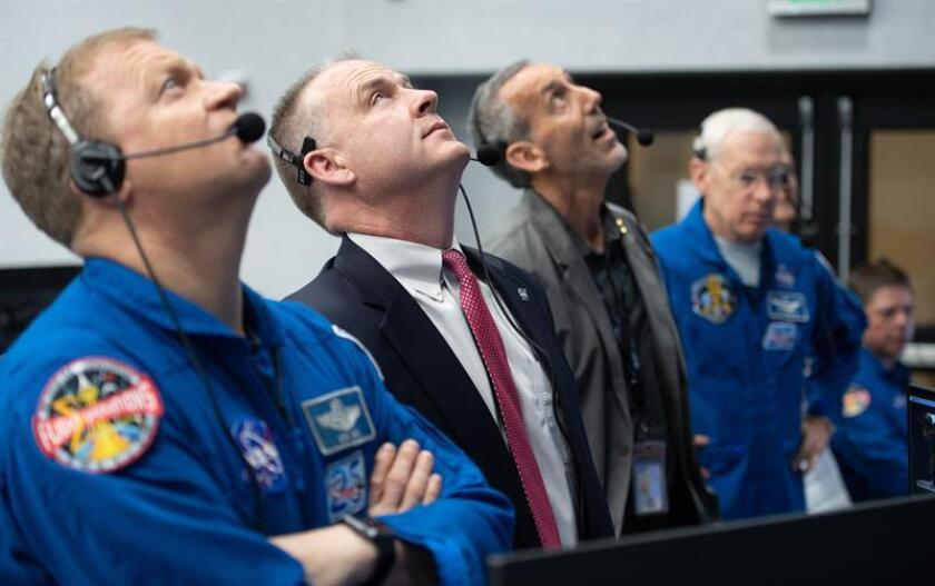 A handout photo made available by the National Aeronautics and Space Administration (NASA)shows NASA astronaut Eric Boe (L), assistant to the chief of the astronaut office for commercial crew; and Norm Knight, deputy director of flight operations at NASA's Johnson Space Center, as they watch the launch of a SpaceX Falcon 9 rocket carrying the company's Crew Dragon spacecraft on the Demo-1 mission on March 2, 2019 at the Kennedy Space Center at Cape Canaveral, Florida. EPA-EFE/NASA / JOEL KOWSKY / HANDOUT MANDATORY CREDIT: (NASA/Joel Kowsky) HANDOUT
