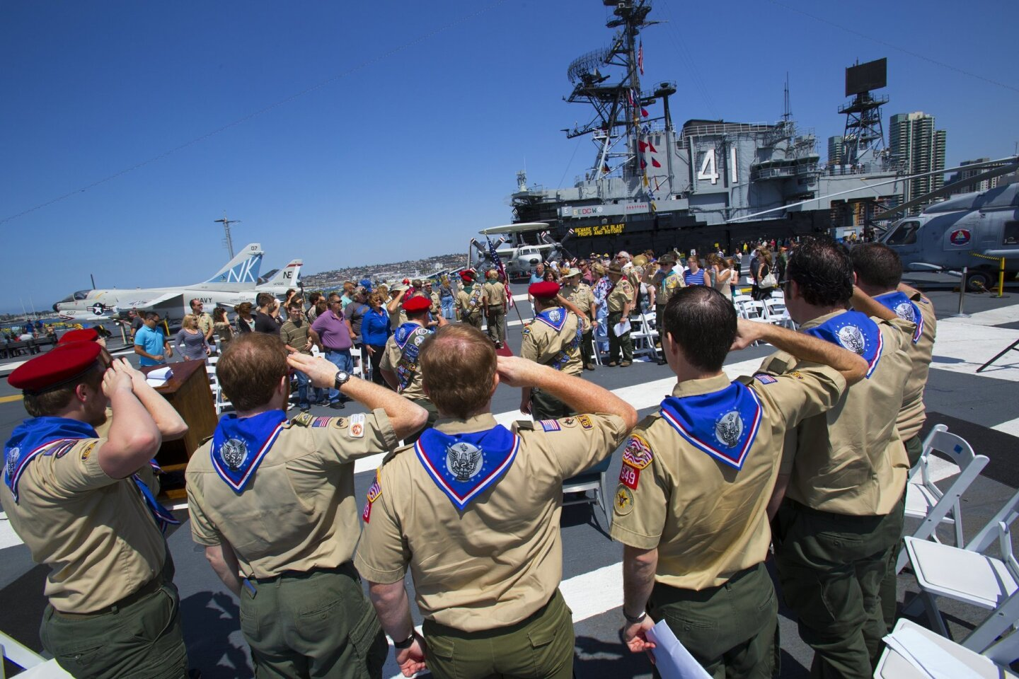 On board the USS Midway 10 Eagle Scouts render the Boys Scout salute during the retiring of the colors.