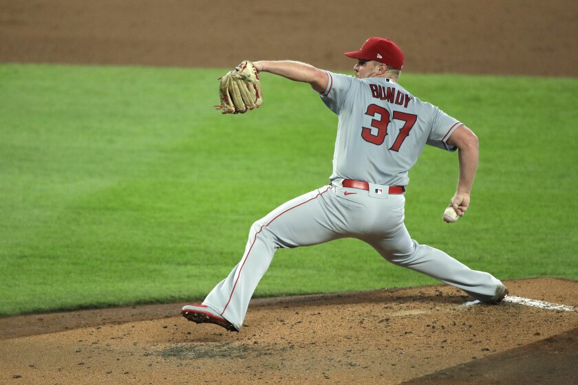 Angels starter Dylan Bundy delivers a pitch against the Seattle Mariners in the third inning Thursday.