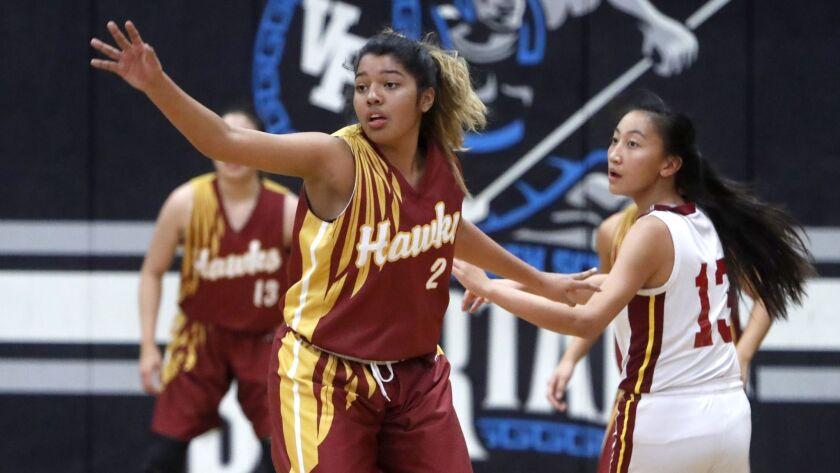 Ocean View High School girls basketball player #2 Kasey Torres plays defense in game vs. El Modena H