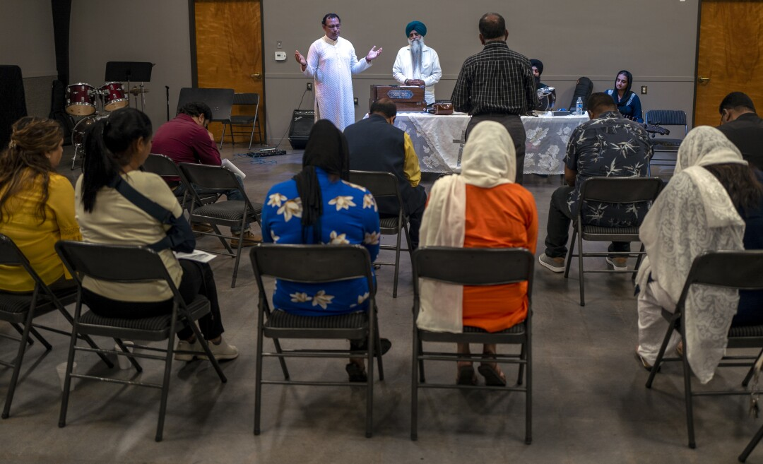 Prayer and choir practice at the Artesia City Church in Artesia.