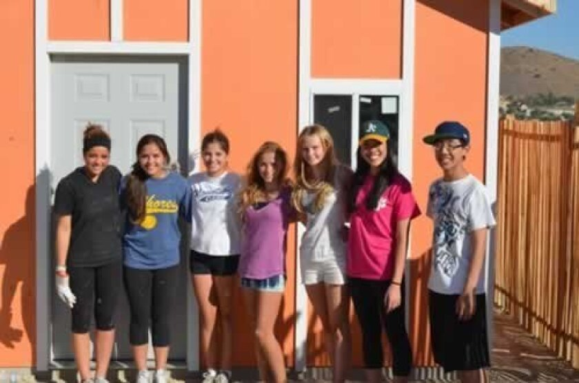 Members of Interact service clubs at The Bishop's School and La Jolla High built a home for a family in Tijuana. Courtesy Photo