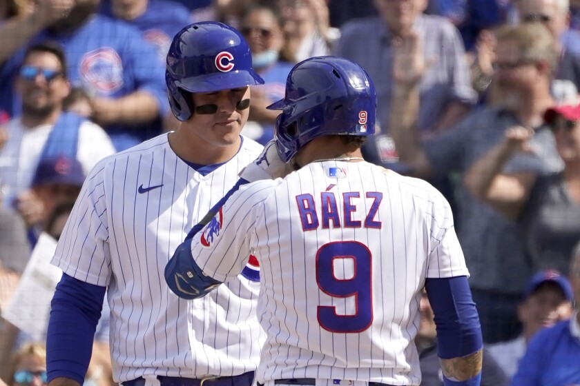 Chicago Cubs' Javier Baez (9) talks to Anthony Rizzo at home plate after Baez's two-run home run off San Diego Padres relief pitcher Miguel Diaz in the seventh inning of a baseball game Wednesday, June 2, 2021, in Chicago. (AP Photo/Charles Rex Arbogast)